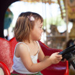 Foto Stock: Girl in carousel car