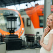 Long-haired pregnant woman waiting train — Stock Photo