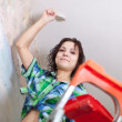girl paints ceiling  — Foto Stock