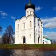Church of Intercession on River Nerl in flood — Stock Photo #35142167