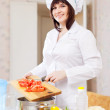 female cook with tomatoes  — Stock Photo