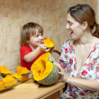 Happy mother with child cooks pumpkin — Stockfoto #35142627