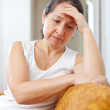 Stock Photo: Sadness mature woman