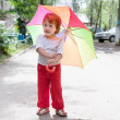 Two-year  girl with umbrella   — Stock Photo