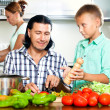 Family cooking in the kitchen — Stock Photo