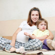 Foto Stock: Pregnant mother with child