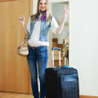 Smiling woman with suitcase — Stock Photo