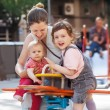 Happy womchildren on swings — Stock fotografie #35143849