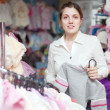 Woman buys clothes for her little daughter   — Stock Photo