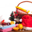 Christmas and beach accessories with basket over white  — Stock Photo