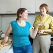 Adult women together cooking in home — Stock Photo