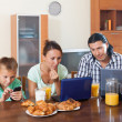 Family of three having breakfast at home — Stock Photo