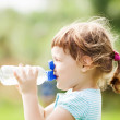 baby drinking from  bottle — Stock Photo