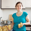 Young housewife cooking potatoes — Stock Photo