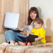 mother and child with laptops — Stock Photo