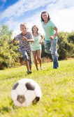 Boy with happy parents playing in soccer — Foto Stock