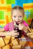 Little girl eating marmalade — Stock Photo