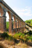 Ancient aqueduct in sunny day — Stock Photo