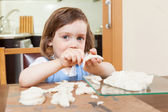 Girl learning to sculpt dough figurines — Stock Photo