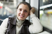 Smiling woman in subway train — Stock Photo