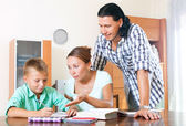 Parents with schoolboy doing homework — Stock Photo