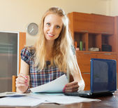 Blonde woman reading financial document — Stock Photo
