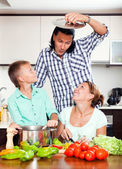Family cooking lunch — Stock Photo