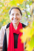 Mature woman in autumn — Stock Photo