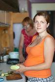 Women cooks with vegetables — ストック写真