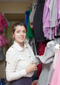 Woman at clothing store — Stock Photo