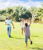 Teenage boy and happy parents playing in soccer — Foto Stock