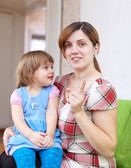 Mother berates her child in interior — Stock Photo