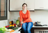 Positive housewife in home kitchen — Stock Photo