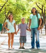 Happy family of three with teenager — Stock Photo