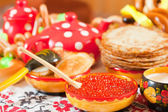 Pancake with red caviar — Stock Photo