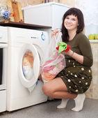 Young housewife doing laundry — Zdjęcie stockowe