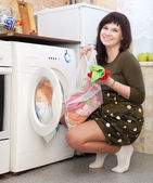 Young housewife doing laundry — Stock Photo