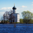 Church of Intercession on River Nerl in flood — Stock Photo #38414403