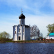 Church of Intercession on River Nerl in flood — Stock Photo #38414699