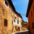Sunny street of old spanish town — Stock Photo