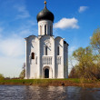 Church of Intercession on River Nerl in flood — Stock Photo #38415017