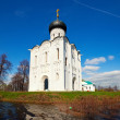 Church of Intercession on River Nerl in flood — Stock Photo #38415315