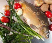 Carp fish with vegetables — Stock Photo