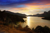 Mountains lake in sunset. Sau reservoir — Stock Photo