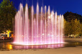 Fountain at town square in night. Sant Adria de Besos — Stock Photo