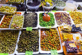 Various marinated olives in cans — Stockfoto