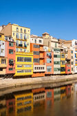 Embankment of river at Girona in sunny da — Stock Photo