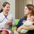 Stock Photo: Doctor of prescribes to baby the medication
