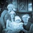 Vintage photo of happy family in Christmas time — Stock Photo