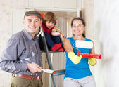 Happy family makes repairs at home — Stock Photo
